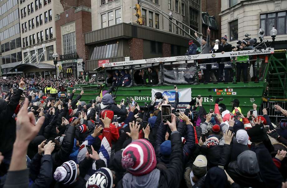 Patriots quarterback Tom Brady (arms raised atop duck boat) takes in the fans' love during Tuesday's parade in Boston. Photo: Charles Krupa, Associated Press