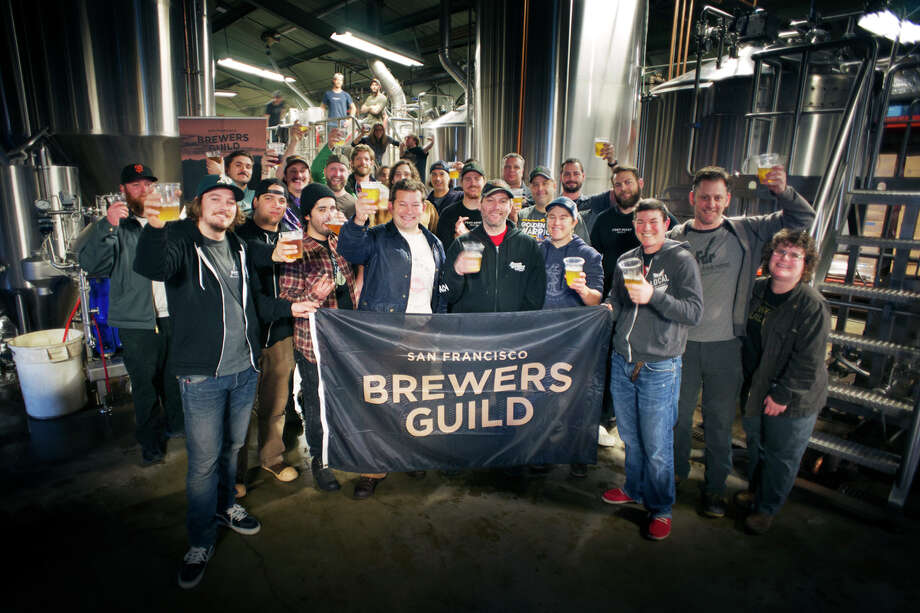 The members of the Brewers Guild pose for a group photo as brew day wraps.