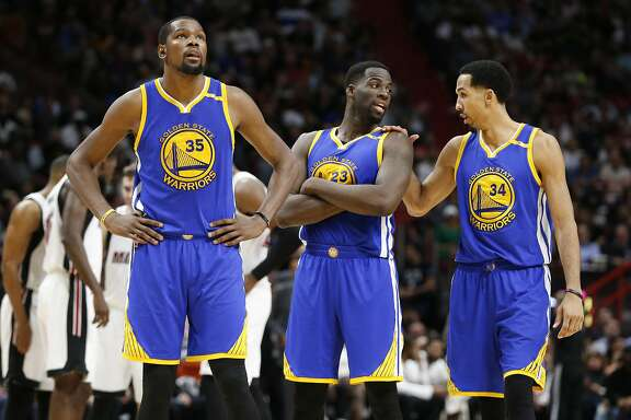 Golden State Warriors forwards Kevin Durant (35) Draymond Green (23) and guard Shaun Livingston (34) are shown during the second half of an NBA basketball game against the Miami Heat, Monday, Jan. 23, 2017, in Miami. The Heat defeated the Warriors 105-102. (AP Photo/Wilfredo Lee)