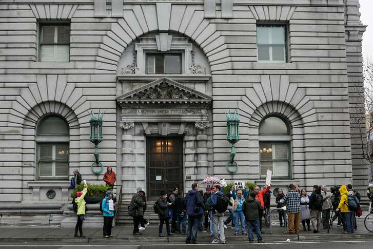 People gather to demonstrate outside of the Ninth Circuit Court of Appeals which is hearing the travel ban case today in San Francisco, California, on Tuesday, Feb. 7, 2017.