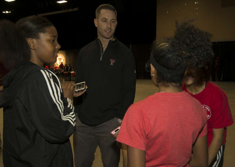Texas Tech Coach Kliff Kingsbury talks with young fans, Kamoria Thomas, Faith Mancha and Ahnalesa Alvarado Tuesday 02-07-17 at the Red Raider Club Recruiting Review at the Midland Horseshoe Pavilion. Tim Fischer/Reporter-Telegram Photo: Tim Fischer/Midland Reporter-Telegram