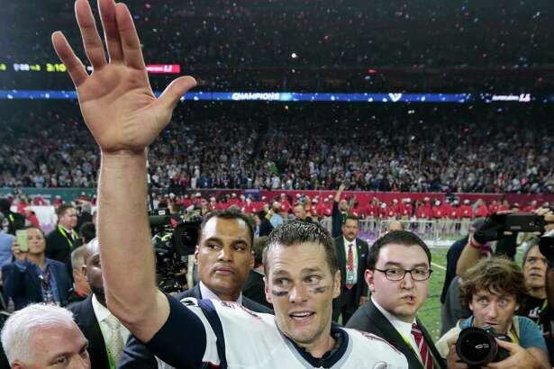 New England Patriots quarterback Tom Brady celebrates the Patriots 34-28 over time win over the Atlanta Falcons in Super Bowl LI at NRG Stadium on Sunday in Houston. ( Brett Coomer / Houston Chronicle )
