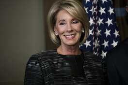 Education Secretary Betsy DeVos during her swearing-in ceremony at the White House in Washington, Feb. 7, 2017. Sen. Susan Collins (R-Maine) and Sen. Lisa Murkowski (R-Alaska) earlier joined Democrats in rejecting DeVos, forcing Vice President Pence to cast a historic tie-breaking vote. (Doug Mills/The New York Times)