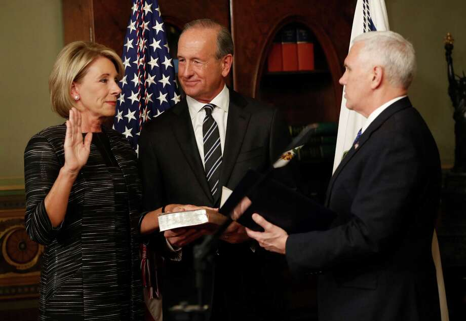 Vice President Mike Pence, right, swears in Education Secretary Betsy DeVos on Tuesday. Photo: Pablo Martinez Monsivais, STF / Copyright 2017 The Associated Press. All rights reserved.
