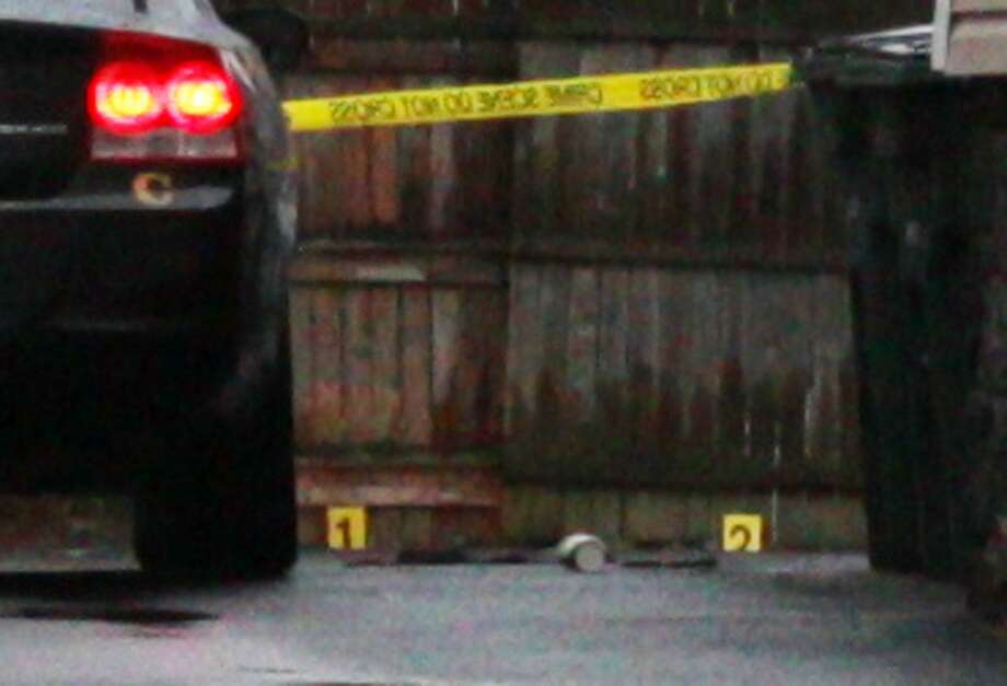 Evidence markers lay at the scene of an early-afternoon shooting in Bridgeport, CT, Feb. 7, 2017. Photo: Cedar Attanasio / Hearst Connecticut Media / Connecticut Post