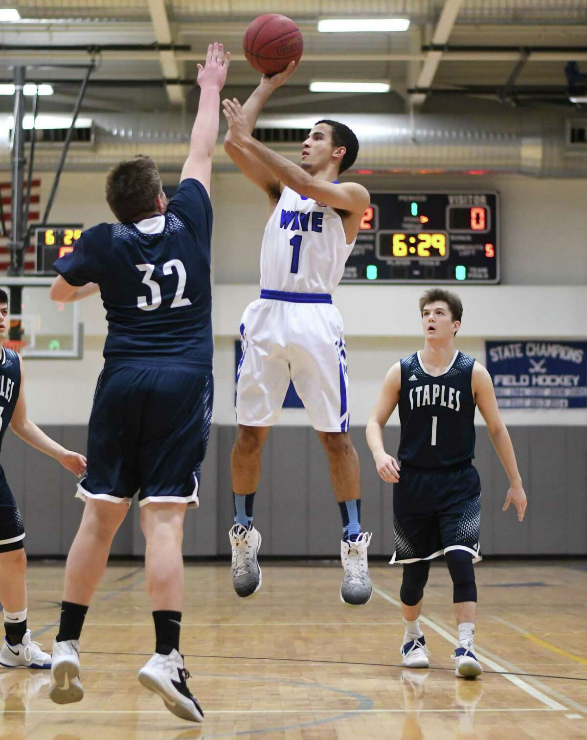 Zak Swetye of Darien takes a jump shot during Tuesday night's game against Staples at Darien High School.