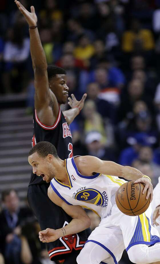 Golden State Warriors' Stephen Curry (30) dribbles around Chicago Bulls' Jimmy Butler during the first half of an NBA basketball game, Thursday, Feb. 6, 2014, in Oakland, Calif. (AP Photo/Marcio Jose Sanchez) Photo: Marcio Jose Sanchez, Associated Press