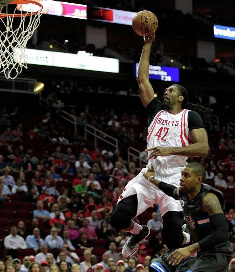 29261464def Houston Rockets center Nene Hilario heads to the basket over Orlando Magic  guard C.J. Watson during