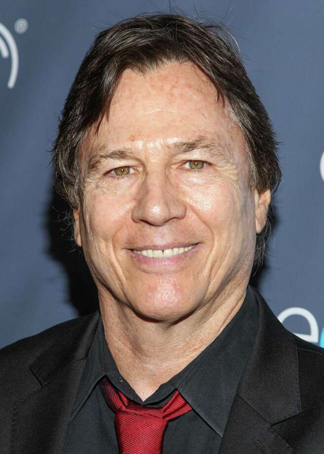 """FILE - In this Aug. 18, 2013 file photo, actor Richard Hatch arrives at the 2013 Geekie Awards at the Avalon in Los Angeles. Hatch, perhaps best known for playing Captain Apollo in the original """"Battlestar Galactica"""" film and TV series, has died at age 71. A representative for the actor says Hatch died Tuesday afternoon, Feb. 7, 2017, after a battle with pancreatic cancer. (Photo by Paul A. Hebert/Invision/AP, File) Photo: Paul A. Hebert, INVL / Invision"""