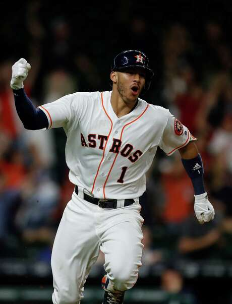 Shortstop Carlos Correa, who at all of 22 years is already an American League star, will be one of the cornerstones in a deeper Astros batting order in 2017. Photo: Karen Warren, Staff Photographer / 2016 Houston Chronicle