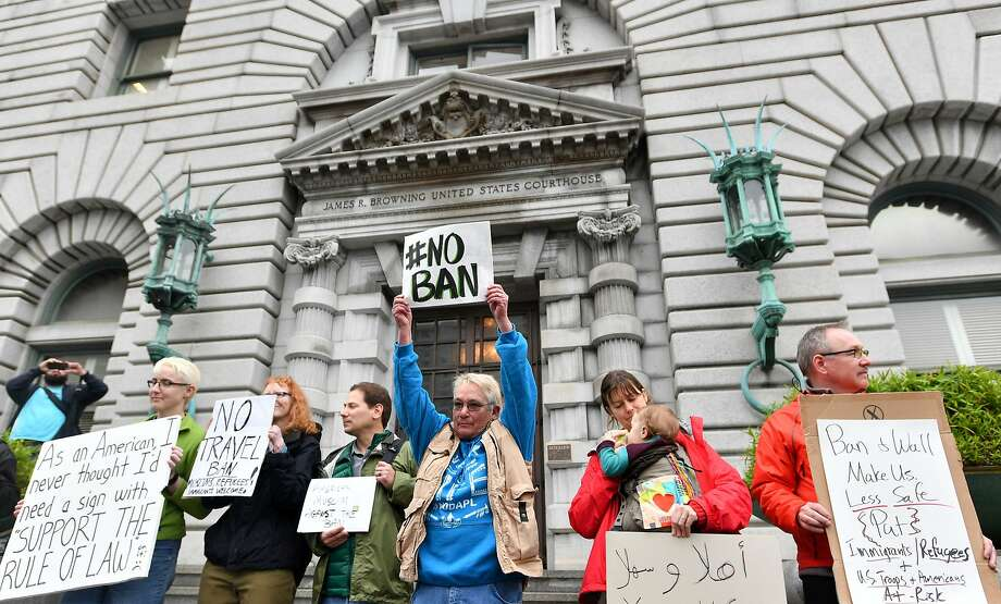 Protesters stand in front of the United States Court of Appeals for the Ninth Circuit in San Francisco, California on February 7, 2017.  A federal appeals court heard arguments on Tuesday on whether to lift a nationwide suspension of President Donald Trump's travel ban targeting citizens of seven Muslim-majority countries. / AFP PHOTO / Josh EdelsonJOSH EDELSON/AFP/Getty Images Photo: JOSH EDELSON, AFP/Getty Images