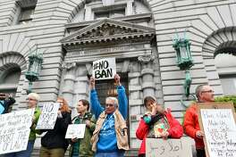 Protesters stand in front of the United States Court of Appeals for the Ninth Circuit in San Francisco, California on February 7, 2017.  A federal appeals court heard arguments on Tuesday on whether to lift a nationwide suspension of President Donald Trump's travel ban targeting citizens of seven Muslim-majority countries. / AFP PHOTO / Josh EdelsonJOSH EDELSON/AFP/Getty Images