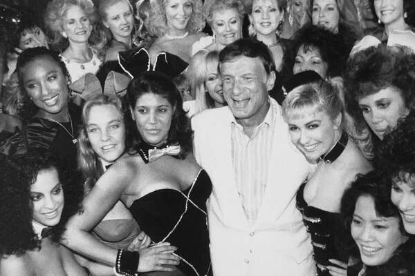 Playboy founder Hugh Hefner poses with a group of Bunnies in 1986 at the Playboy Club in Los Angeles, days before the club closed. Hefner once had 30 Playboy Clubs around the world.