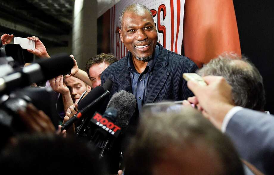 Retired Houston Rockets center and member of the Naismith Memorial Basketball Hall of Fame Hakeem Olajuwon speaks to the media before an NBA basketball game between the Houston Rockets and Orlando Magic, Tuesday, Feb. 7, 2017, in Houston. Olajuwon will be honored during the game as part of the Houston Rockets' 50th anniversary celebration. (AP Photo/Eric Christian Smith) Photo: Eric Christian Smith, FRE / FR171023 AP