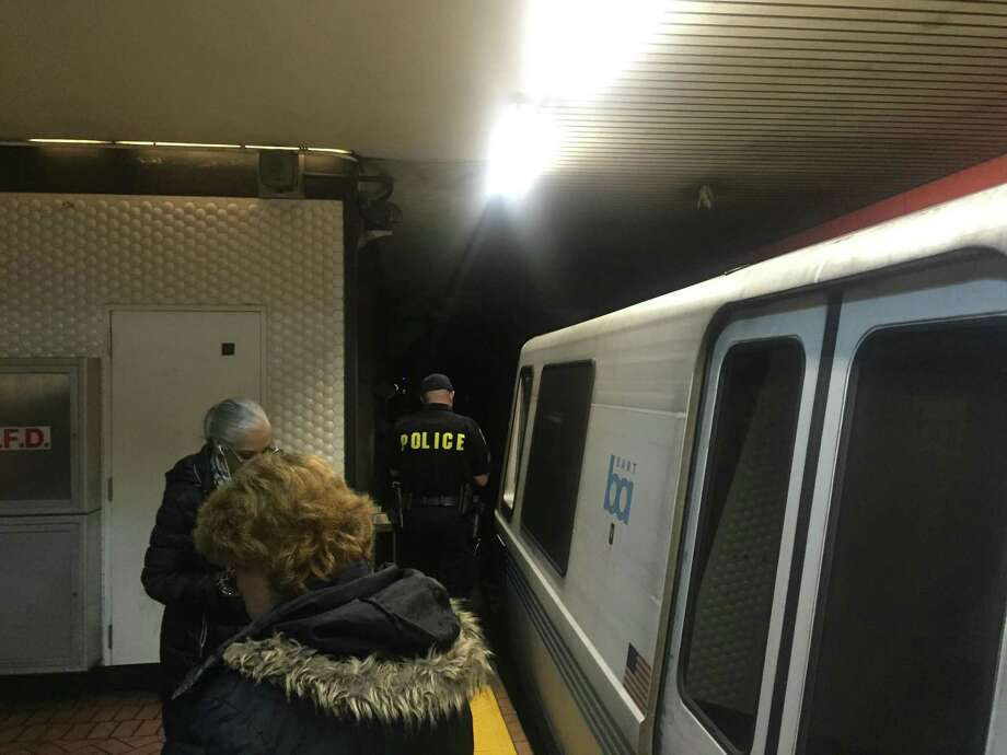 Police at San Francisco's Powell BART Station searched the tunnel toward Montgomery Station for a person said to be walking on the tracks Tuesday night. Photo: Trapper Byrne / San Francisco Chronicle / Trapper Byrne / San Francisco Chronicle