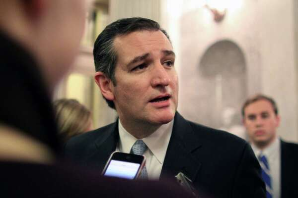 Sen. Ted Cruz (R-TX) talks with reporters after the Senate voted on a $1.1 trillion spending bill to fund the government through the next fiscal year on on Saturday, Dec. 13, 2014 on Capitol Hill in Washington. (AP Photo/Lauren Victoria Burke)