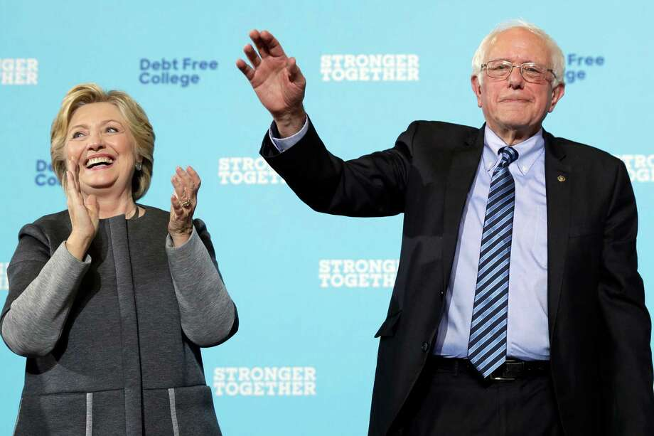 Democratic presidential candidate Hillary Clinton and Sen. Bernie Sanders, I-Vt. acknowledge the audience at a campaign stop at the University Of New Hampshire in Durham, N.H., Wednesday, Sept. 28, 2016. Photo: Matt Rourke, STF / AP