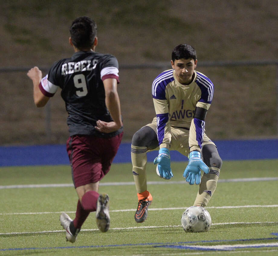Midland High keeper Pedro Cereceres (1) takes control of the ball in front of Lee's Jose Guttierrez (9) on Tuesday, Feb. 7, 2017, at Grande Communications Stadium. James Durbin/Reporter-Telegram Photo: James Durbin