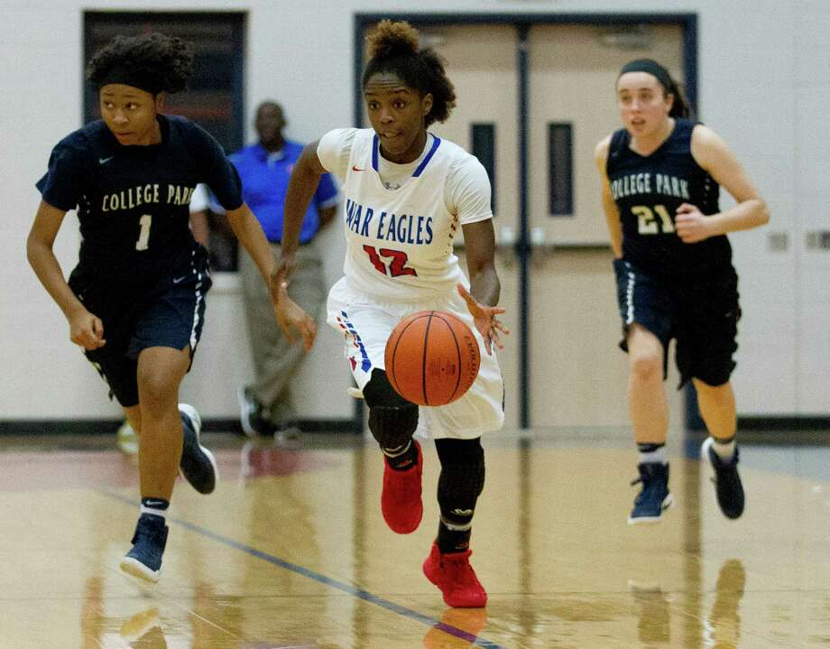 Oak Ridge point guard Yazmine Kellough (12) starts a fast break as College Park guardsJ asmine Handy (1) and Allison Warren (21) give chase during the fourth quarter.  of a District 12-6A high school girls basketball game at Oak Ridge High School Tuesday, Feb. 7, 2017, in Conroe. Oak Ridge defeated College Park 54-39 for the District 12-6A girls basketball championship. Photo: Jason Fochtman, Staff Photographer / © 2017 Houston Chronicle
