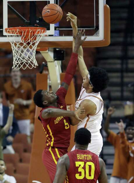 Jarrett Allen, who led Texas with 17 points and nine rebounds, scores over Iowa State's Merrill Holden. Photo: Eric Gay, STF / Copyright 2017 The Associated Press. All rights reserved.