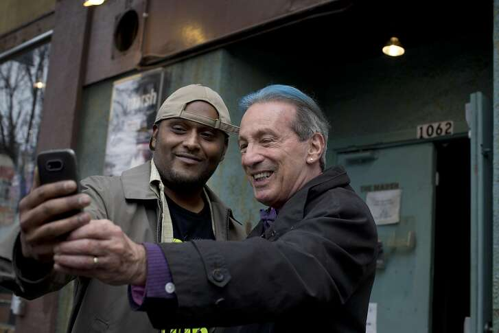 Former San Francisco Supervisor and State Assemblyman Tom Ammiano, right, takes a selfie with Shaibaan Ali, left, at the Marsh Theater in San Francisco, Calif., on Tuesday, February 7, 2017.