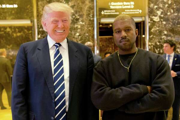 FILE - In this Dec. 13, 2016, file photo, President-elect Donald Trump and Kanye West pose for a picture in the lobby of Trump Tower in New York. West has deleted tweets posted on Dec. 13, 2016, explaining the meeting. (AP Photo/Seth Wenig, File) ORG XMIT: PAPM104