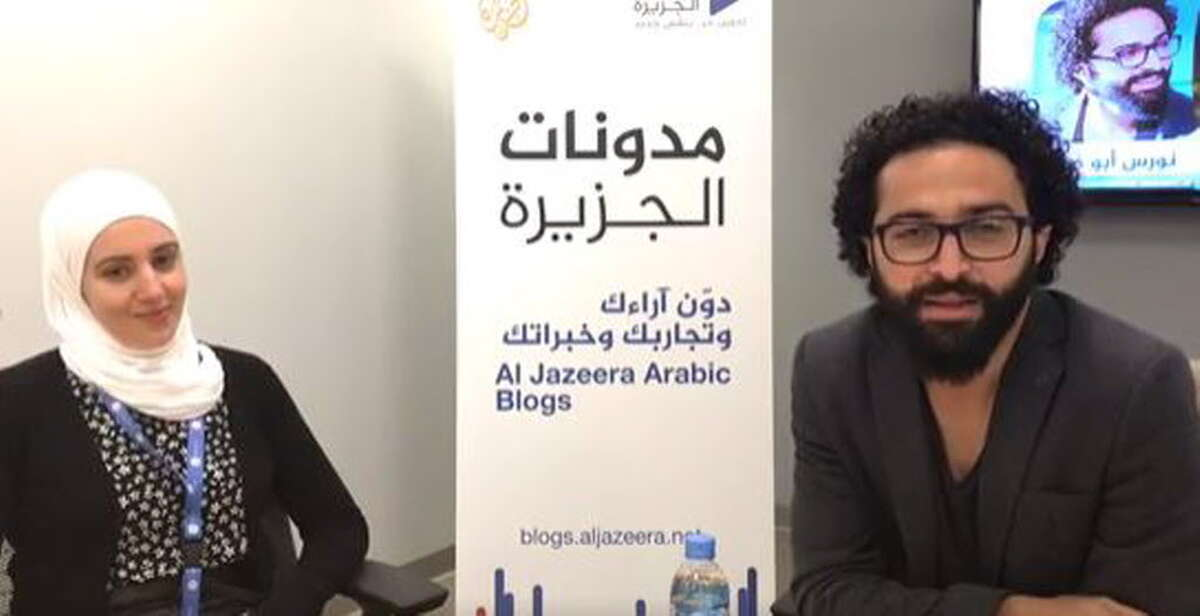 Sirin Hamsho, left, did an interview with Palestine film director Nawras Abu Saleh for Al Jazeera in Qatar just before President Donald Trump's now-lifted travel ban was put into place. Source: Al Jazeera