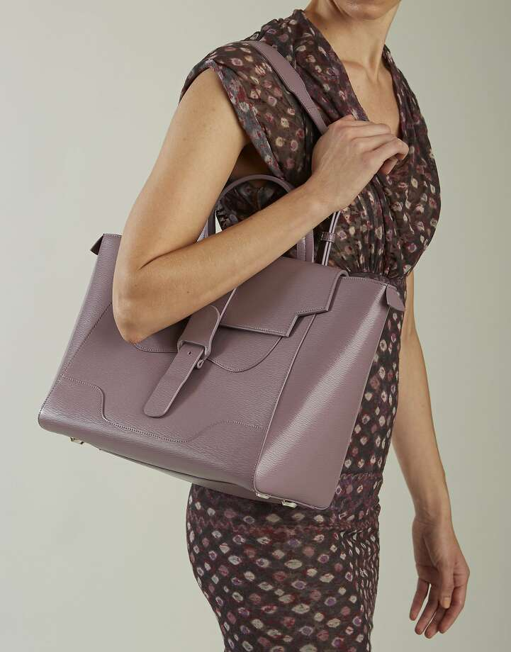The founders of Senreve believe their brand will address millennial women's needs and aspirations with a line of sleek leather handbags offered at relatively reasonable price: under $1,000. Pictured is the Lilac Maestra Bag ($895), made from pebbled leather in Italy, in factories that also work with Balenciaga and Fendi. Photo: San Francisco