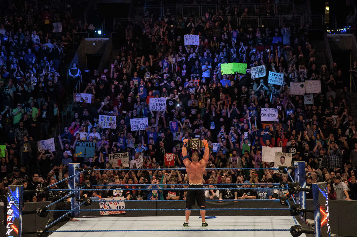 John Cena shows the crowd his championship belt during WWE Smackdown Live at KeyArena on Tuesday, Feb. 7, 2017.