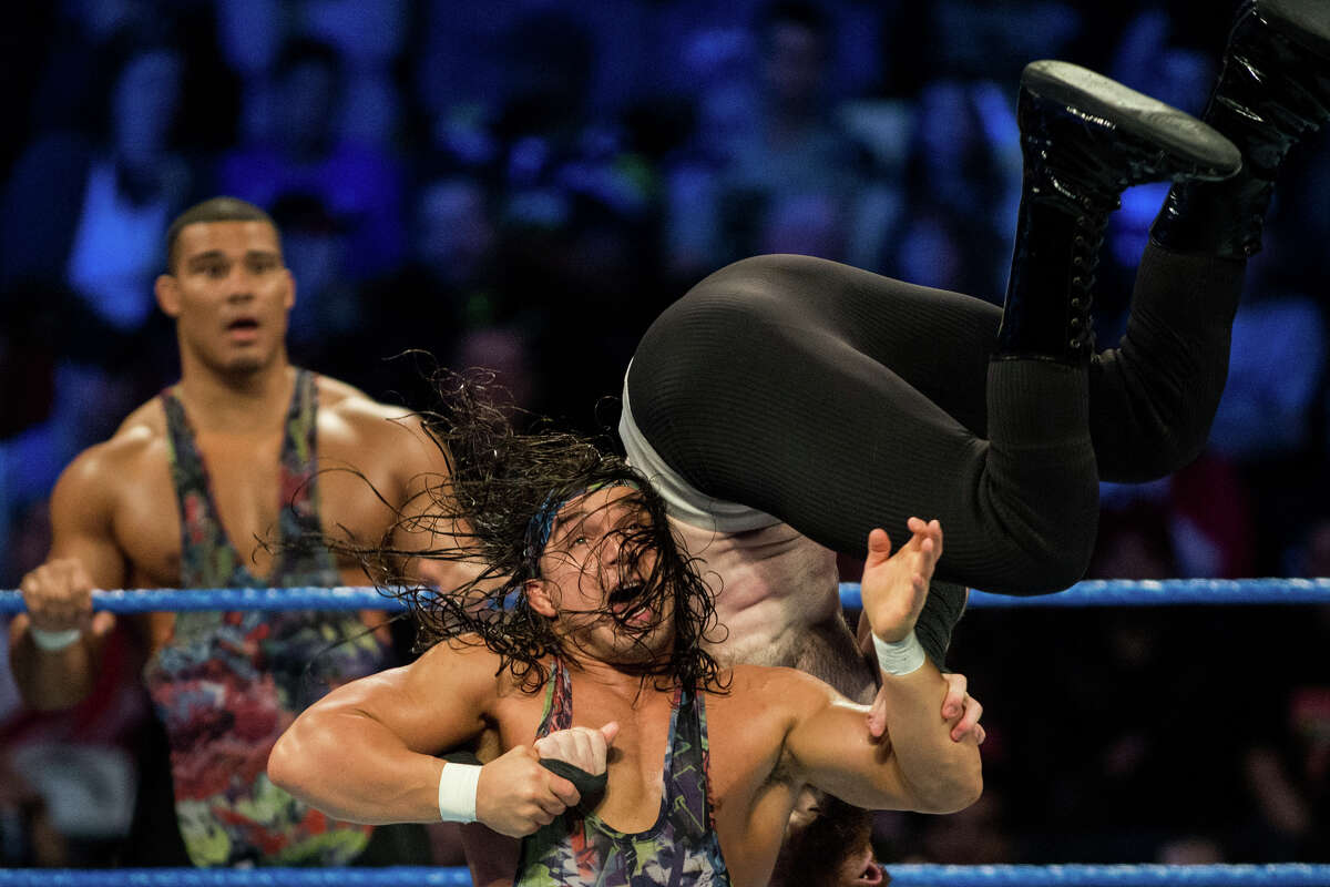 Chad Gable tosses Aiden English over his shoulder.