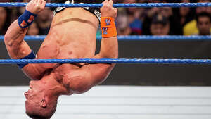 John Cena clutches on to the ropes while battling Ryan Orton during WWE Smackdown Live at KeyArena on Tuesday, Feb. 7, 2017.
