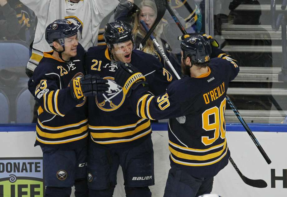 Sabres forward Kyle Okposo (21) celebrates with teammates after his goal tied the game 4-4 in the third period in Buffalo, N.Y. Photo: Jeffrey T. Barnes, Associated Press