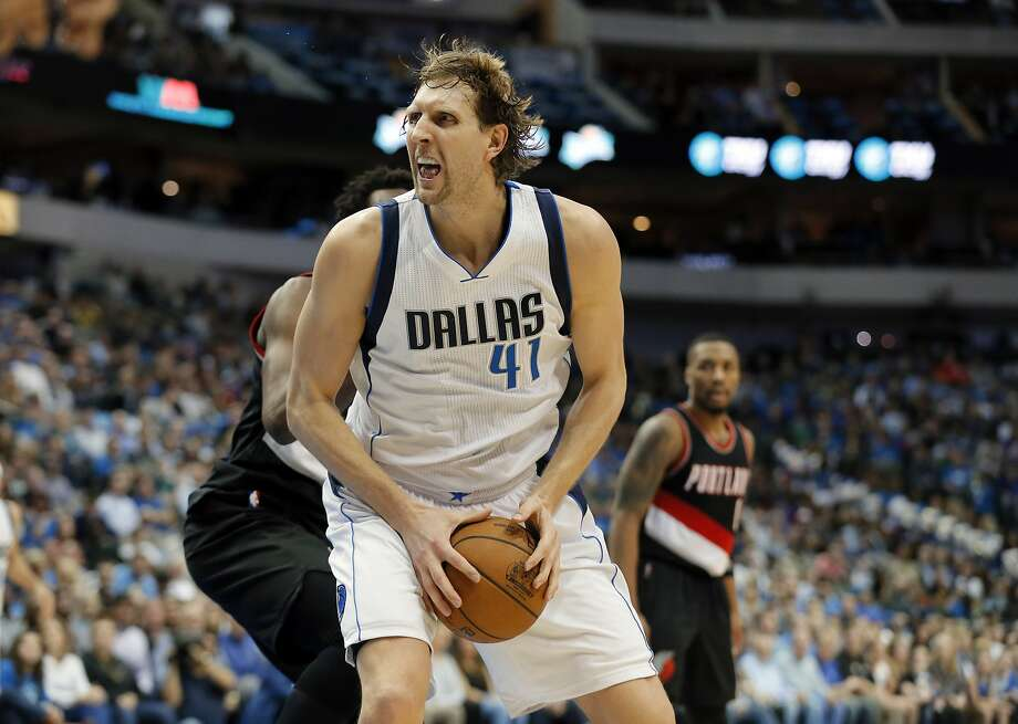 Dallas' Dirk Nowitzki emerges from a four-game slump to score 25 points, including a clutch three with 3.9 seconds left. Photo: Tony Gutierrez, Associated Press