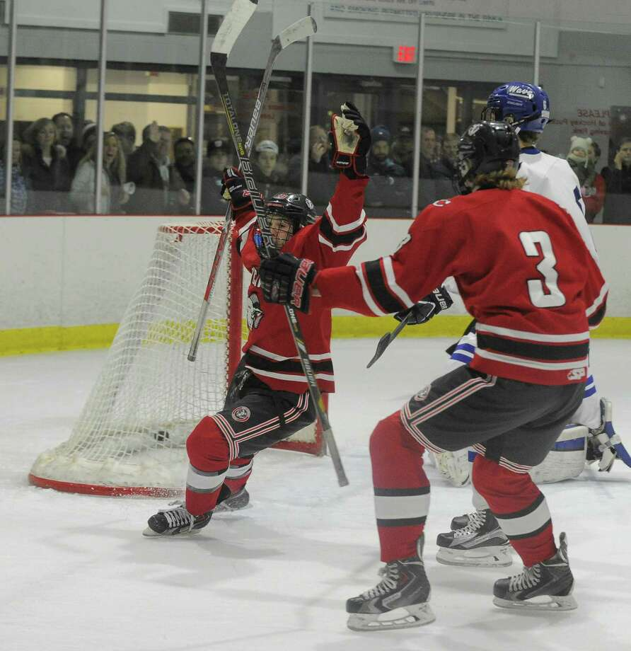 New Canaan Gunnar Granito (18) celebrates a first period goal against Darien in a boys hockey game at the Darien Ice Rink in Darien on Feb. 4, 2017. New Canaan defeated Darien 4-1. Photo: Matthew Brown / Hearst Connecticut Media / Stamford Advocate