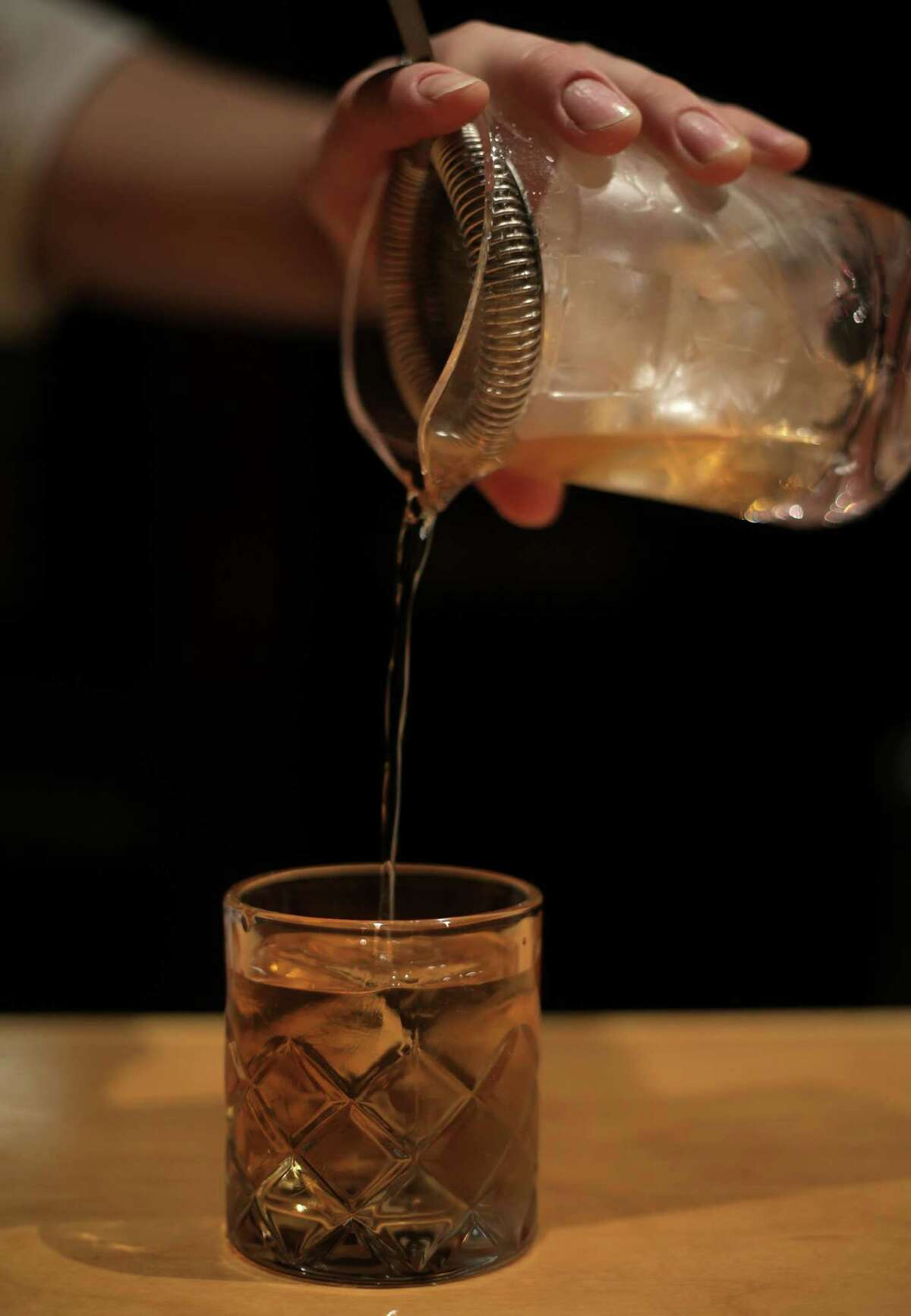 Peter Jahnke pours out a Rusty Nail at Tongue-Cut Sparrow, 310 Main, in downtown Houston.