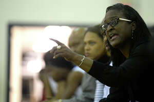 Ozen head coach Tammy Walker-Brown takes in the action as she coaches from the sidelines as the Lady Panthers face Livingston during their final home game Tuesday. Coach Brown was surprised with a special half-time ceremony celebrating her 10th straight district title winning season.  Photo taken Tuesday, February 7, 2017 Kim Brent/The Enterprise