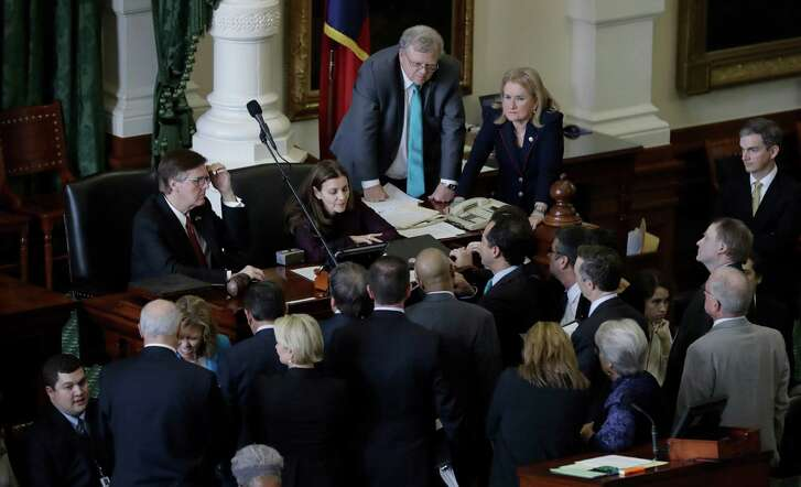 "Senators gather around Lt. Gov. Dan Patrick, left, during a point of order as the Texas Senate debates a contentious ""sanctuary cities"" proposal that would compel local police to enforce federal immigration laws and is on track to be the first piece of legislation passed by either chamber this session, Tuesday, Feb. 7, 2017, at the Texas Capitol in Austin, Texas. (AP Photo/Eric Gay)"