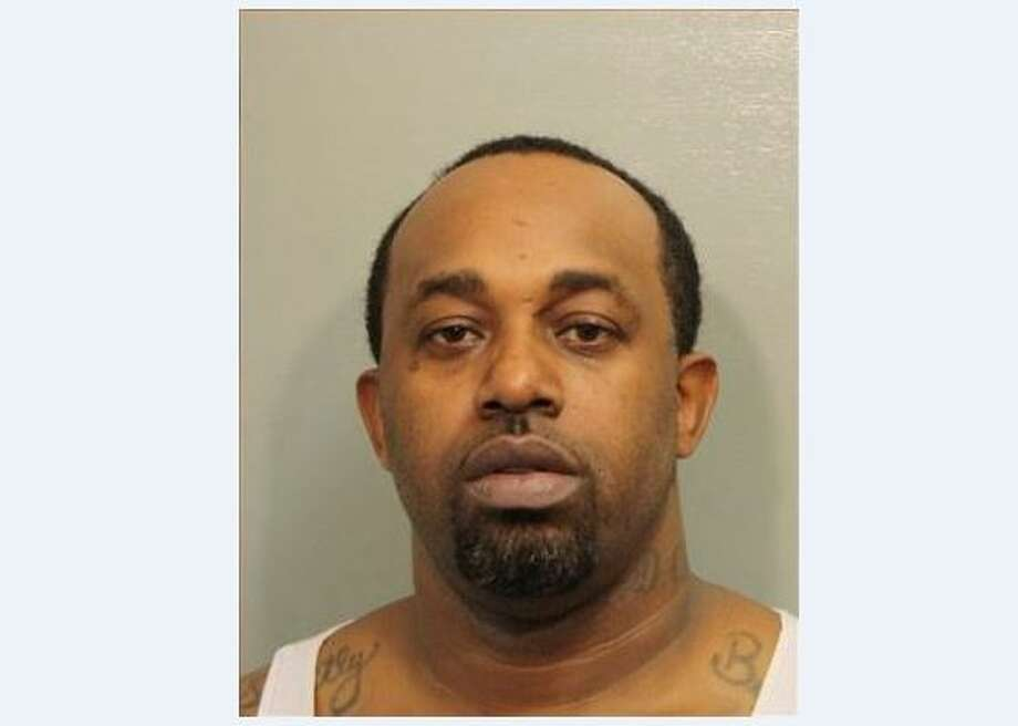 Curtis Champs Jr., 38, was arrested after his daughters were found on a curb holding bags of cocaine.>Click to see recent drug busts n Houston.  Photo: Harris County Sheriff's Office