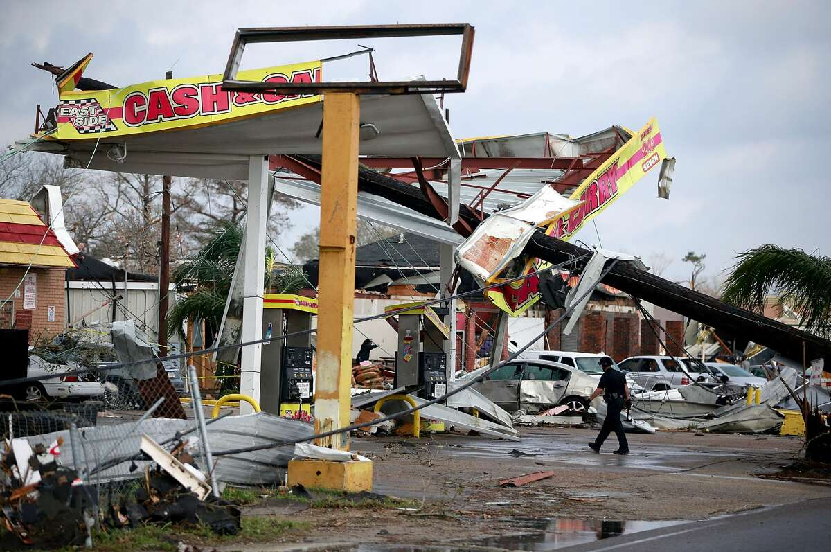 Tornados in New Orleans A police officer walks through a damaged gas station along Chef Menture Avenue after a tornado touched down in the eastern part of the city on February 7, 2017 in New Orleans, Louisiana. According to the weather service, 25 people were injured in the aftermath of the tornado.