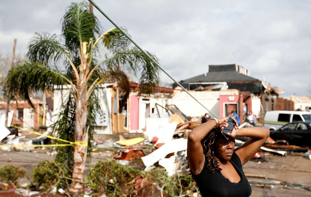 A woman looks at the wreckage caused by a tornado which touched down along Chef Menture Avenue on February 7, 2017 in New Orleans, Louisiana. According to the weather service 25 people were injured in the aftermath of the tornado. Click through to see more images of the tornado's damage.