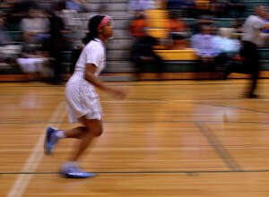 Legacy Christian Academy's Alexis Morris runs down the court during her final home game against Rosehill Christian on Tuesday evening. Morris, a McDonald's All-American, will play college basketball at Baylor.  Photo taken Tuesday 2/7/17 Ryan Pelham/The Enterprise