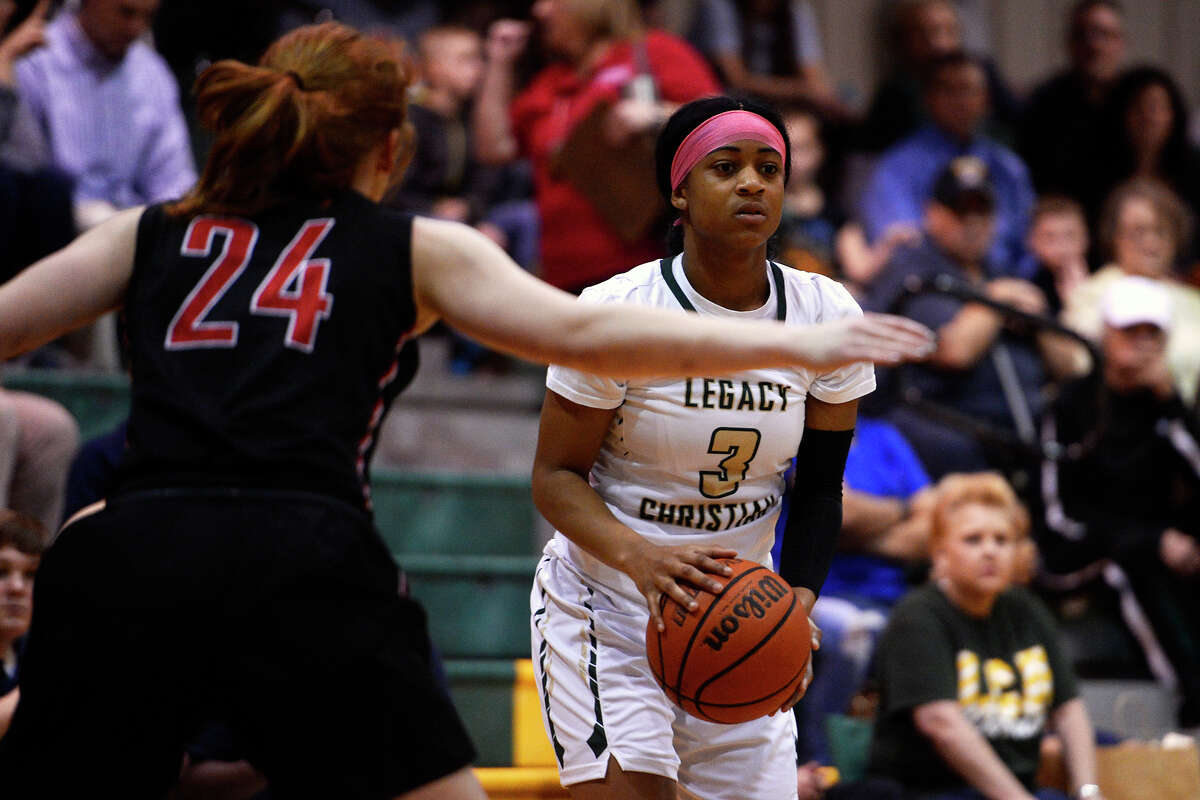 Legacy Christian Academy's Alexis Morris looks to pass during her final home game against Rosehill Christian on Tuesday evening. Morris, a McDonald's All-American, will play college basketball at Baylor. Photo taken Tuesday 2/7/17 Ryan Pelham/The Enterprise