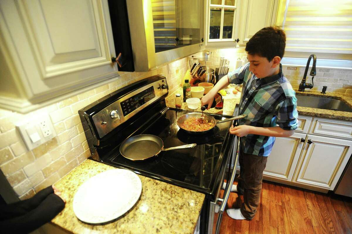 11-year-old Adrian Corelli, a contestant on Chopped Jr., cooks a birds nest inside his kitchen on Ridge Park Ave. in Stamford, Conn. on Wednesday, Feb. 1, 2017. His episode premieres at 8 p.m. Feb. 14 on the Food Network.