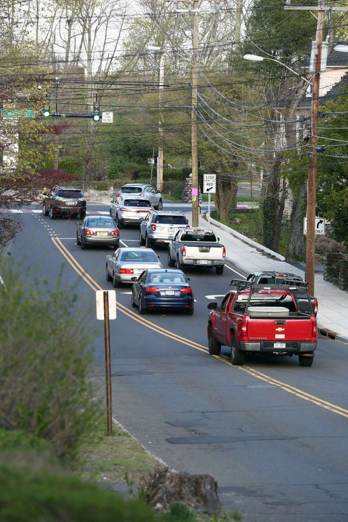 Cars wait at the corner of Weed Hill Avenue and Hope Street on Thursday, April 21, 2016. Springdale residents have conducted their own traffic study using smart phones, video and spreadsheets in response to a city-run traffic study that determined the addition of 500 housing units will not increase the neighborhood traffic.