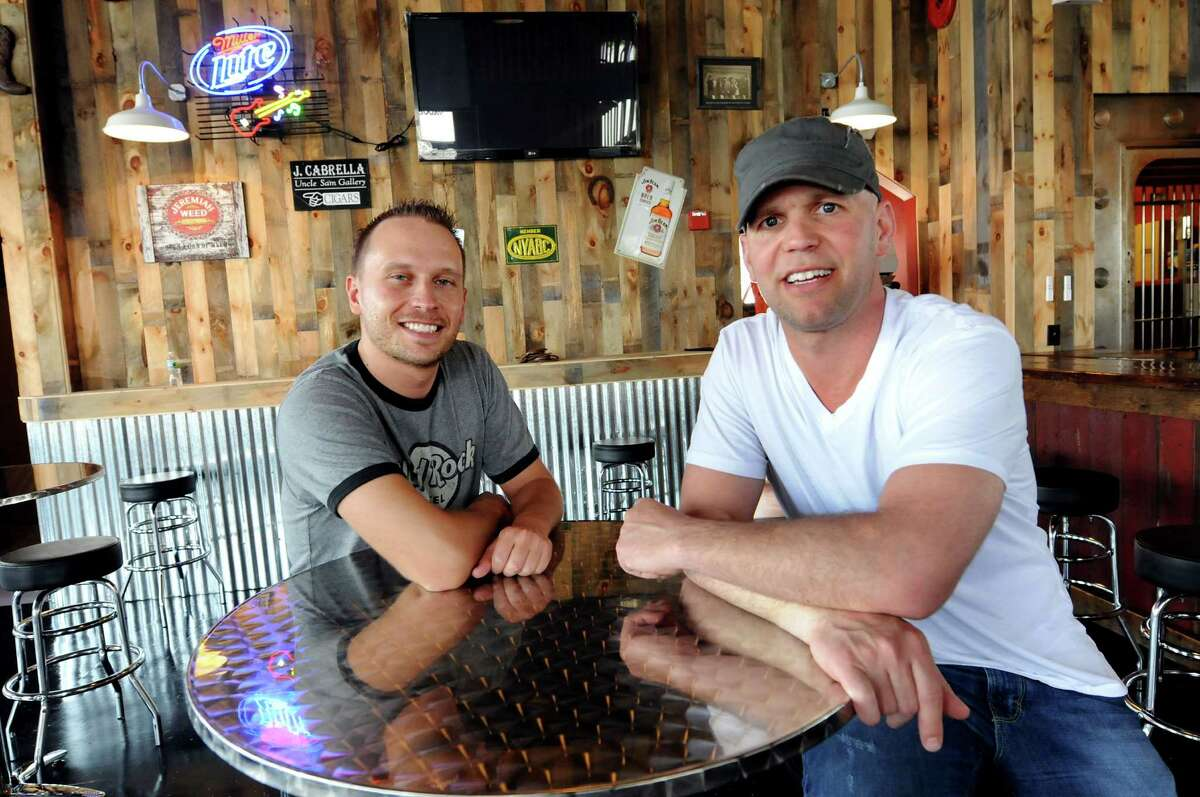 Business partners Alessio Depoli, left, and Chris Pratt the Barrel Saloon, which they owned in Albany's warehouse district from 2011 to 2017. (Cindy Schultz/Times Union)