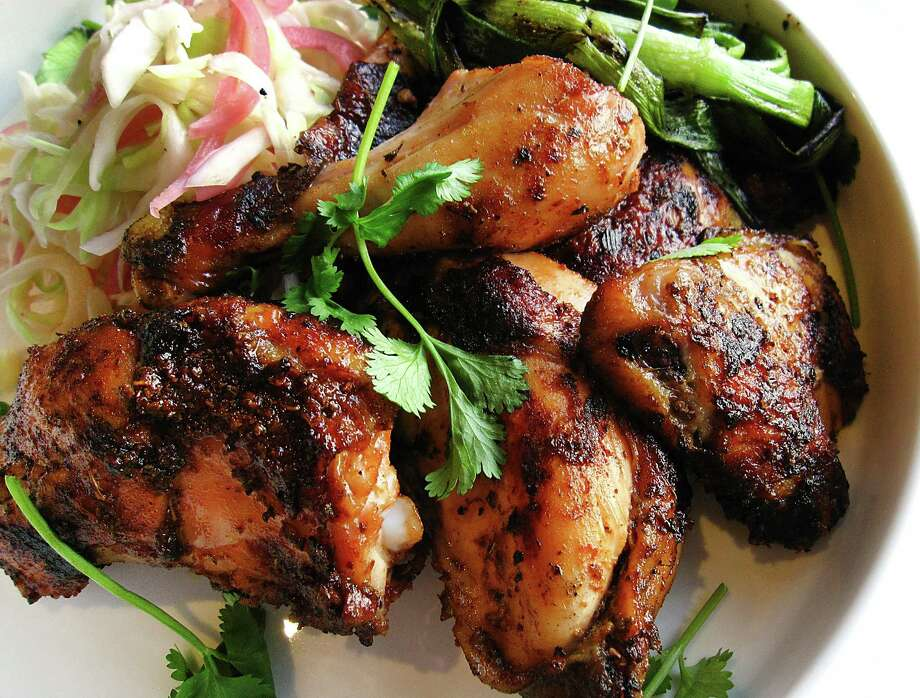 """Chisme Chisme might call its chicken """"pollo asado,"""" but it's just as accurate to think of it as the juicy, spicy, deftly roasted chicken every respectable restaurant should have on its menu, this one dressed out with rice, beans, tortillas and a vinegary tangle of cabbage and pickled onions. 2403 N. St. Mary's, 210-530-4236, eatchisme.com. Photo: Mike Sutter /San Antonio Express-News"""