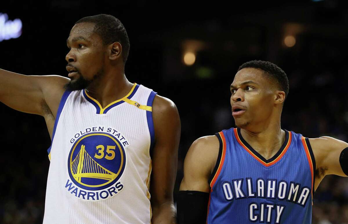 OAKLAND, CA - JANUARY 18: Kevin Durant #35 of the Golden State Warriors and Russell Westbrook #0 of the Oklahoma City Thunder point in different directions after the ball went out of bounds at ORACLE Arena on January 18, 2017 in Oakland, California. NOTE TO USER: User expressly acknowledges and agrees that, by downloading and or using this photograph, User is consenting to the terms and conditions of the Getty Images License Agreement.
