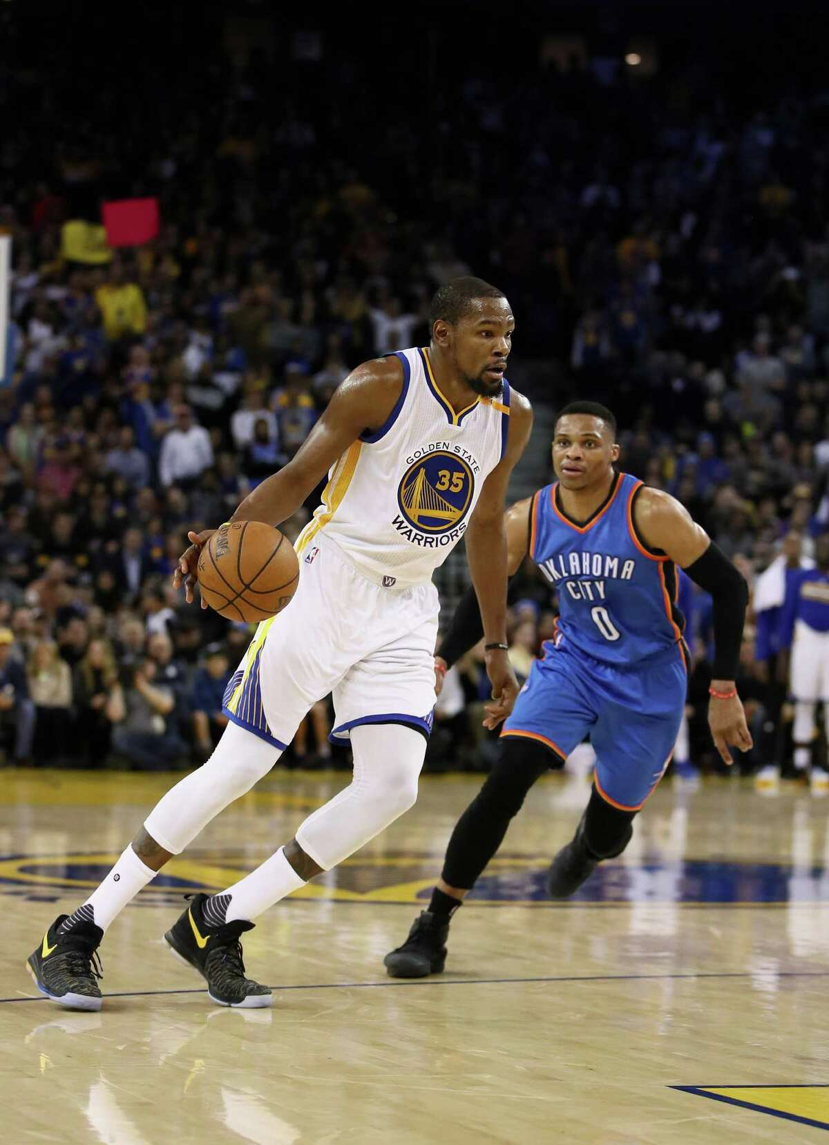 OAKLAND, CA - JANUARY 18: Kevin Durant #35 of the Golden State Warriors dribbles past Russell Westbrook #0 of the Oklahoma City Thunder at ORACLE Arena on January 18, 2017 in Oakland, California. NOTE TO USER: User expressly acknowledges and agrees that, by downloading and or using this photograph, User is consenting to the terms and conditions of the Getty Images License Agreement.