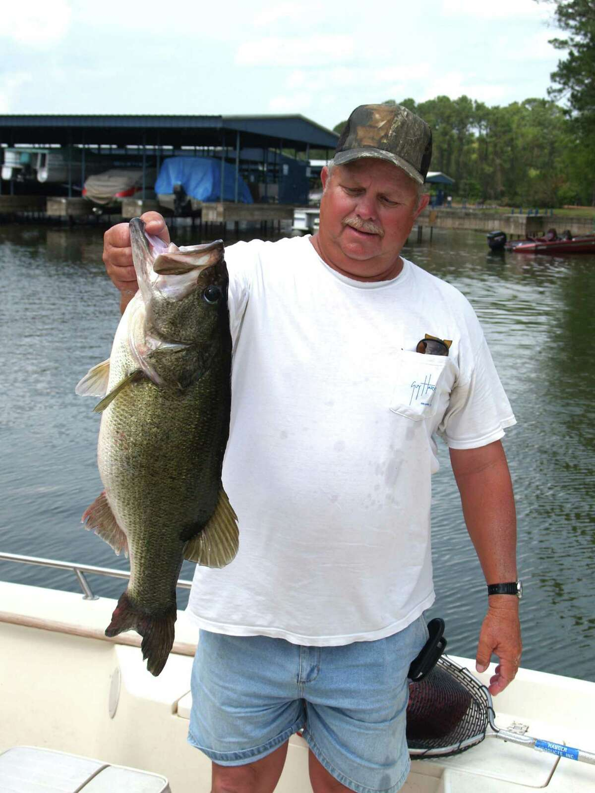 Fishing guide Butch Terpe took this bass from the nest when he and I were fishing. He released the bass back near it?s nest.