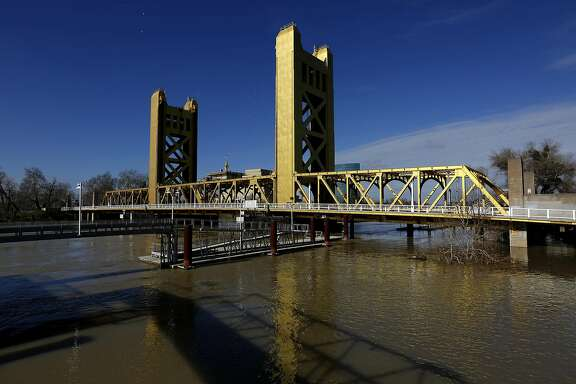 The Sacramento River flows under the Tower Bridge in Sacramento, Calif., on January 25, 2017. Heavy amounts of rain has led to the floodgates of the Fremont Weir and Sacramento Weir to be opened, filling the Yolo Bypass with water from the Sacramento River. The bypass protects Sacramento and other riverside communities from flooding. (Gary Coronado/Los Angeles Times/TNS)